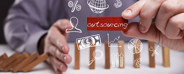 What is outsourcing and why do companies use it?